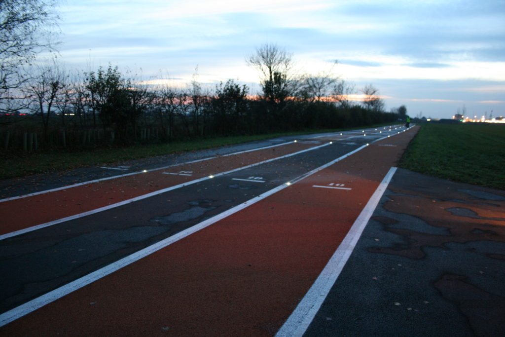Running track with solar ground lights