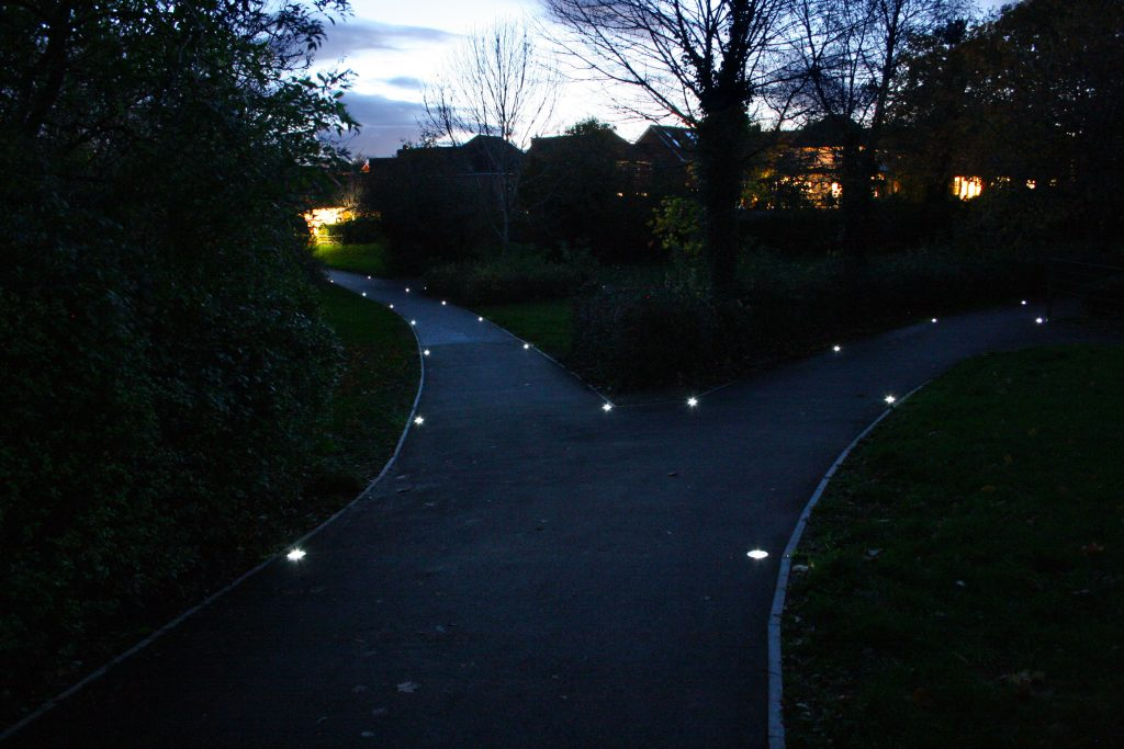 solar lighting on pathway which splits in two directions
