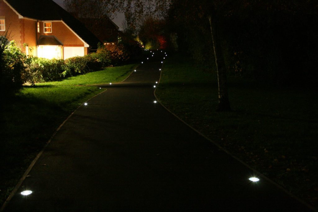 solar lighting on pathway by houses