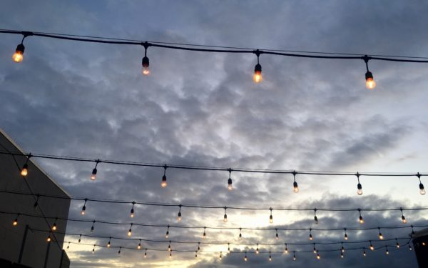 Outdoor string lights against the sky